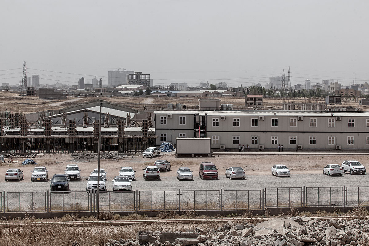 Hamdaniyah University, originally located in Qaraqosh, was later moved to the north of Erbil. 'Once security is established in Qaraqosh, we have to go back,' says university president Muzahim Alkhyatt. [Sebastian Castelier/Al Jazeera]