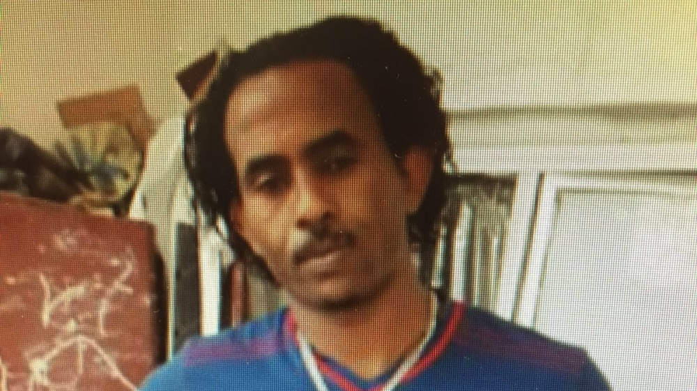 Eritrean Medhane Yehdego Mered, accused of organising a trafficking route through Africa, is flown to Rome from Sudan.