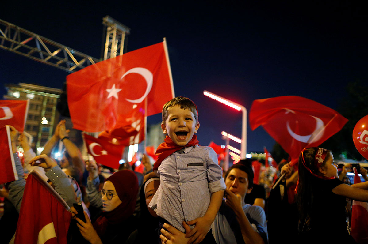Supporters of Turkish President Tayyip Erdogan attend a pro-government demonstration at Taksim Square in Istanbul. [Ammar Awad/Reuters]