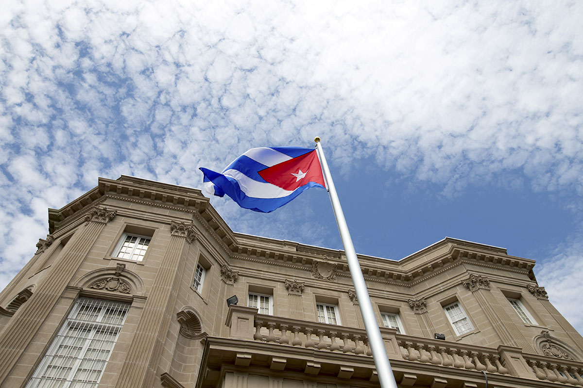 The Cuban flag was raised over Havana's embassy in Washington on Monday, July 20, 2015 for the first time in 54 years as the United States and Cuba formally restored relations, opening a new chapter of engagement between the former Cold War foes. [Andrew Harnik/Pool/Reuters]