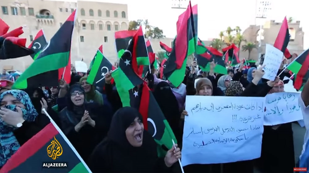 The UN-backed government in Tripoli condemns France's military involvement in the country as hundreds protest.