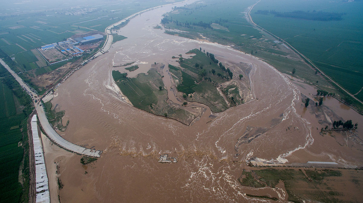 An aerial view shows flooded roads and fields in Xingtai, Hebei Province. [Reuters]