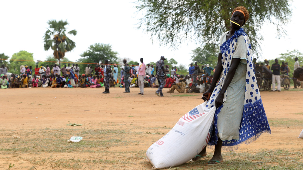 Hunger and conflict force tens of thousands to abandon their fields and migrate north to Sudan.