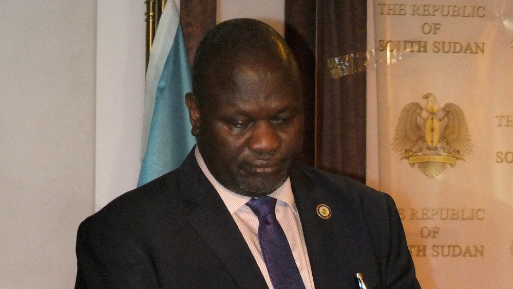"In an exclusive interview with Al Jazeera, Riek Machar says he is ""around Juba"" and he is still first VP of South Sudan."