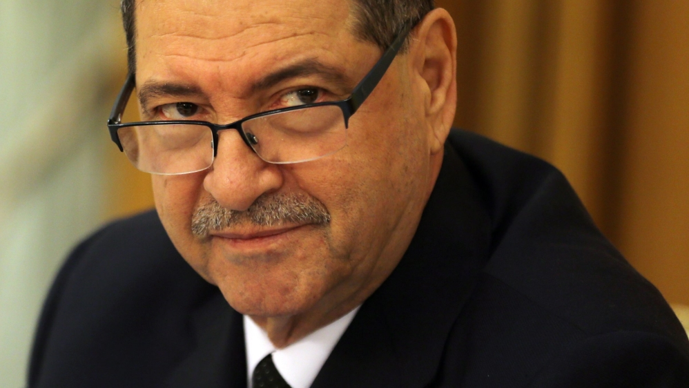 Members of Tunisia's parliament vote Prime Minister Habib Essid out of office 18 months after his appointment.