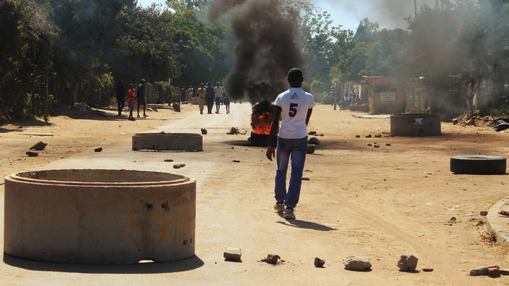 Zimbabweans carry out nationwide strike and protests in the capital against the economic conditions in the country.