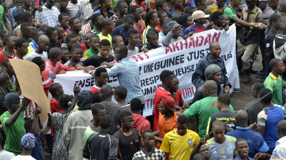 One man shot dead and 12 wounded as at least half a million protest against alleged government corruption.