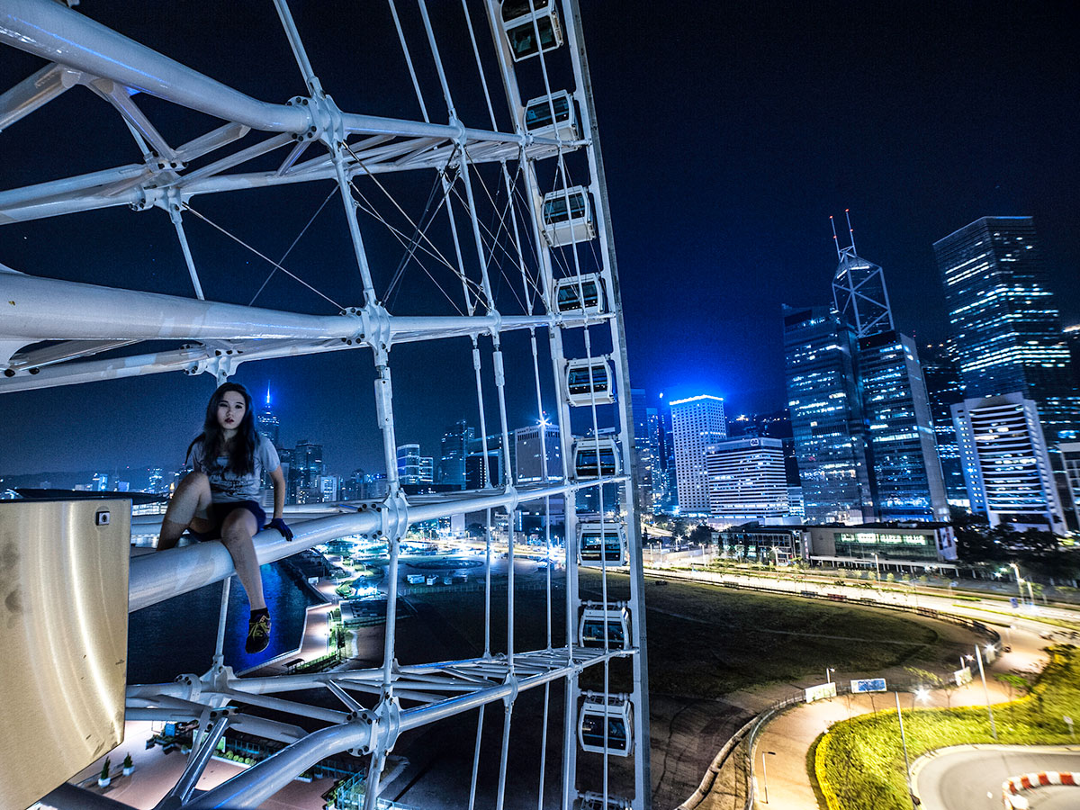 Rebel queen of the Hong Kong rooftopping and urban exploring scene, Airin T climbs above the city lights to terrifying heights. [Airin T / Al Jazeera]