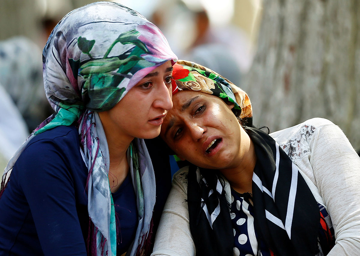 A suicide bomber as young as 12 killed at least 51 people at a wedding in Turkey, President Recep Tayyip Erdogan said Sunday, pointing the finger at ISIL. [Osman Orsal/Reuters]