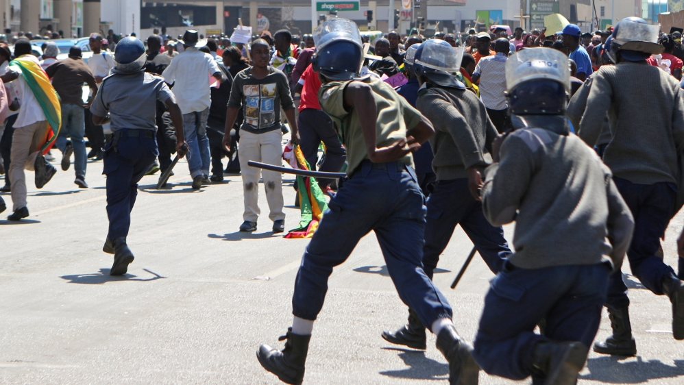 Tear gas, water cannons and batons used to disperse rally in capital Harare with unconfirmed reports of injuries.