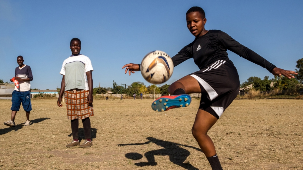 Football team makes it to the Olympics despite degrading camp conditions, poor diet, low pay and taxing road trips.