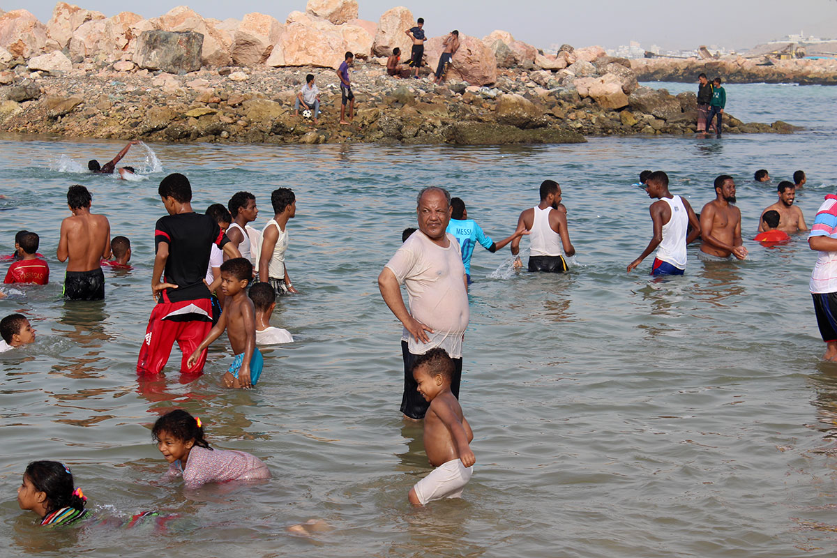 Although many Yemenis flocked to enjoy the water, they had to exercise caution, as the country's coastguard services have crumbled during the war. [Rashed Bin Shoubrag/Al Jazeera]