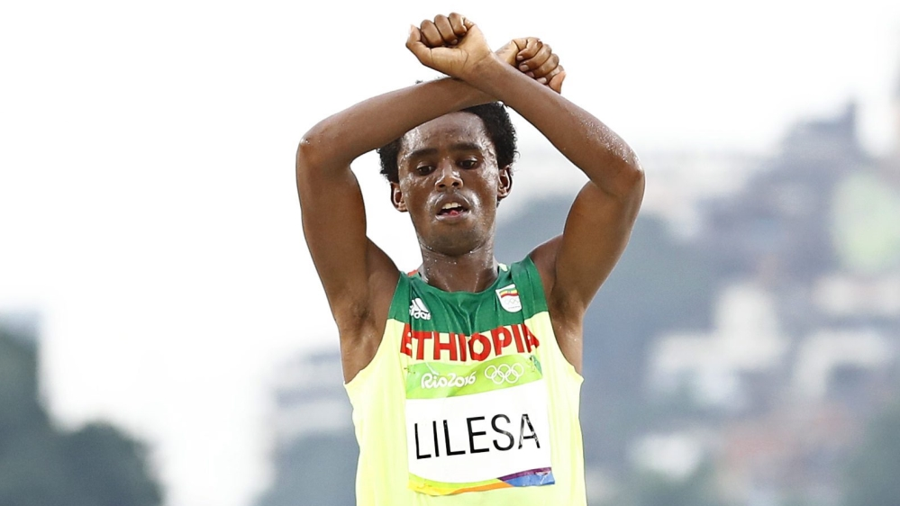 """Long-distance runner who won silver for Ethiopia at Olympic Games in Rio wants """"superiority of one ethnic group to end""""."""