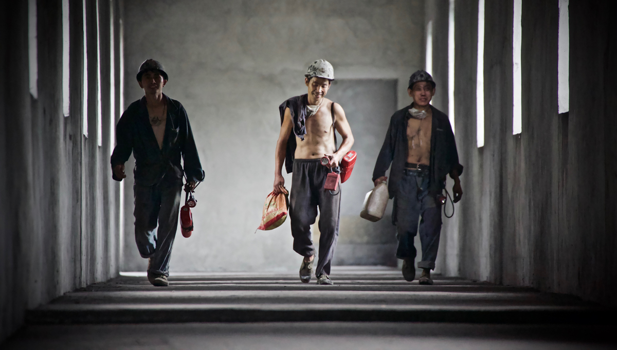 Coal miners come off their shift in Southwest China. Beyond the gruelling conditions they endure, the life of miners is increasingly hard - with falling wages, and layoffs, caused by the slump in commodity prices. [Steve Chao/Al Jazeera]