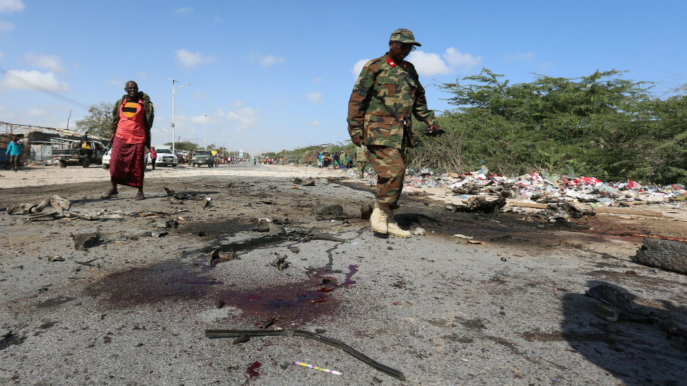 Military convoy targeted in deadly suicide attack claimed by al-Shabab in Somali capital.