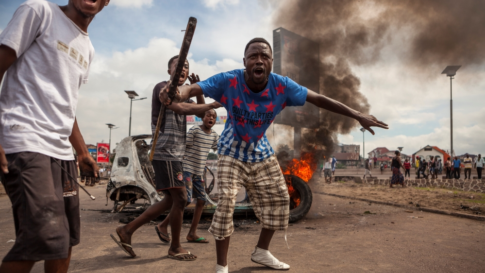 Government bans demonstrations against President Kabila after 17 people, including three policemen, killed in clashes.