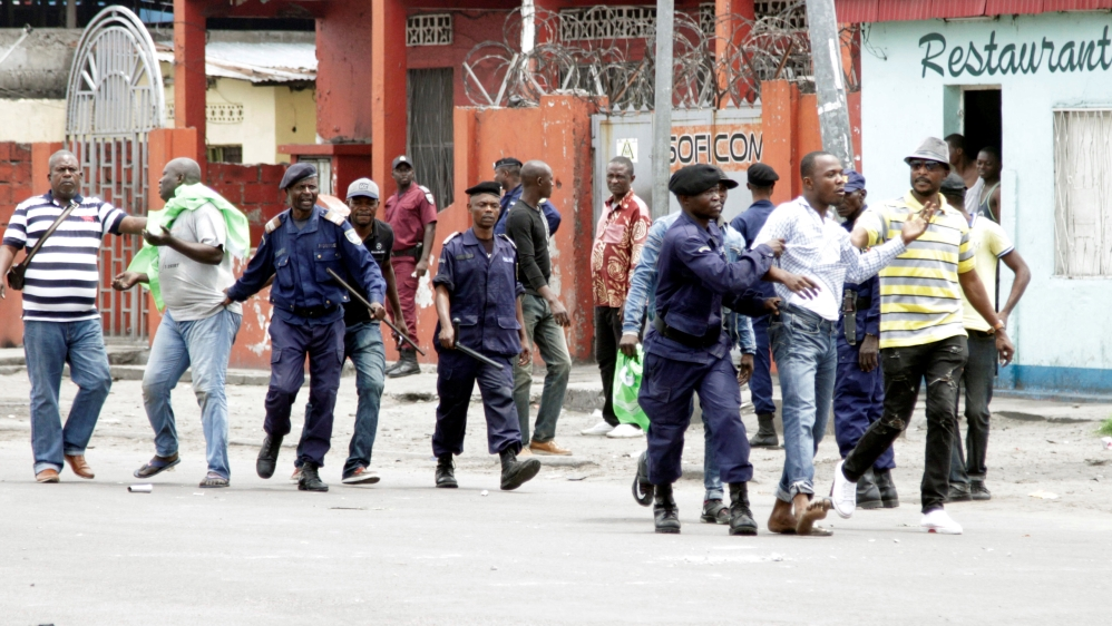 Opposition says two days of violence in Kinshasa left more than 100 dead, while the police put the death toll at 32.
