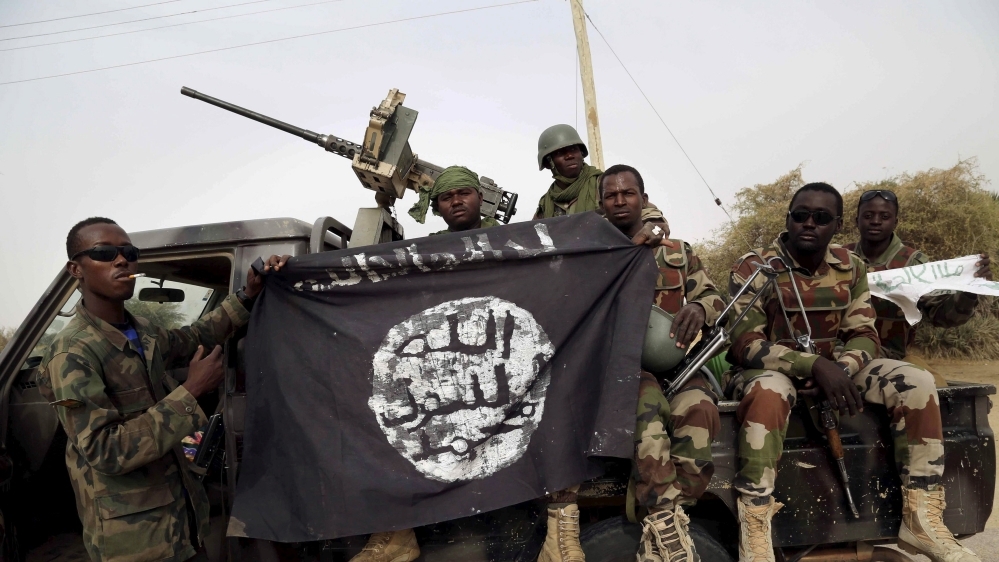 Nigerian and regional forces clash with Boko Haram fighters for control of Malam Fatori town in northeast Borno state.