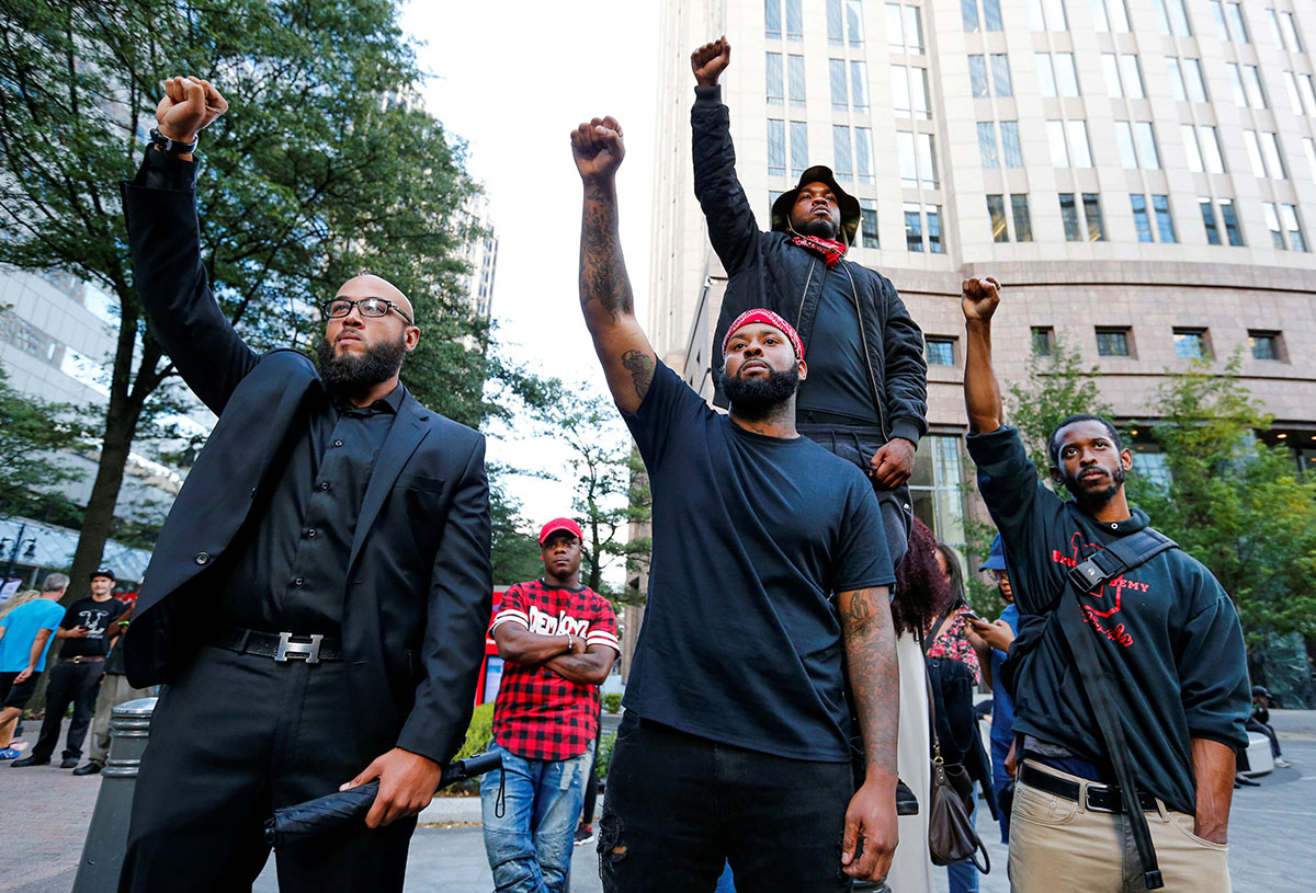 Protesters gather at the intersection of Trade and Tryon Streets in Charlotte, North Carolina, to rally against the killing of Keith Scott by police. [Jason Miczek/Reuters]