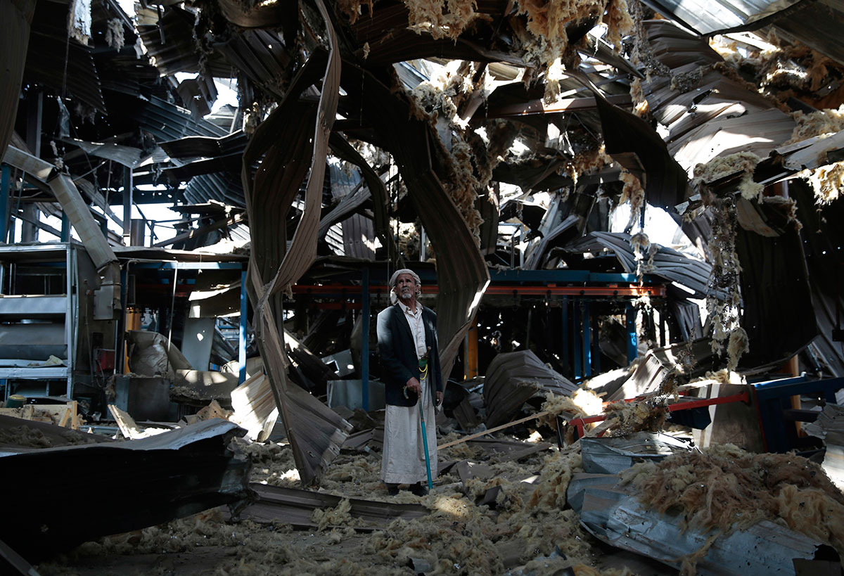 An elderly man stands among the rubble of the Alsonidar Group's water pump and pipe factory after it was hit by Saudi-led air raids in Sanaa, Yemen. The Saudi-led coalition has been carrying out attacks on Yemen's Houthi rebels and their allies since March 2015. [Hani Mohammed/AP]