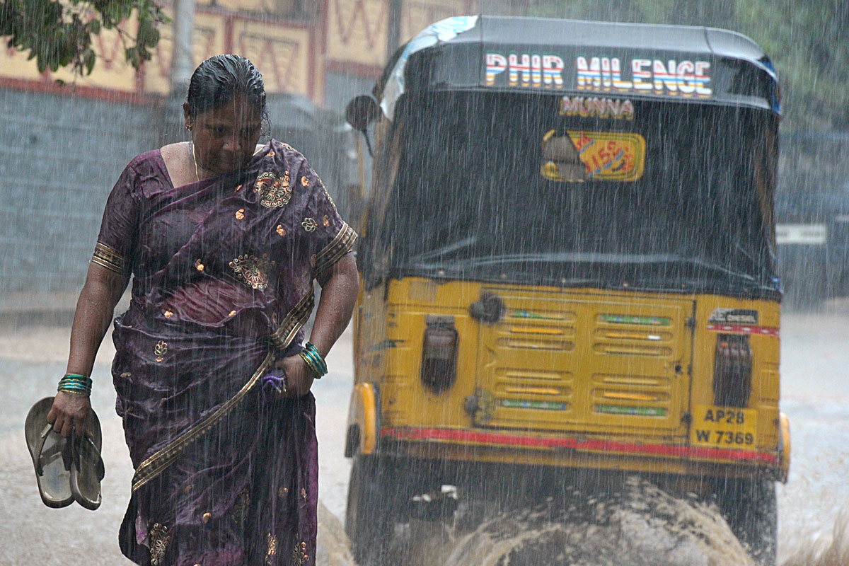 Torrential rain has fallen across the Indian states of Telangana and Andhra Pradesh. [Noah Seelam/AFP]