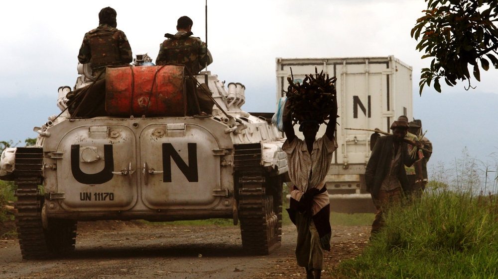 Local authorities say at least 34 civilians killed by Nande ethnic militia in attack on camp for displaced people.