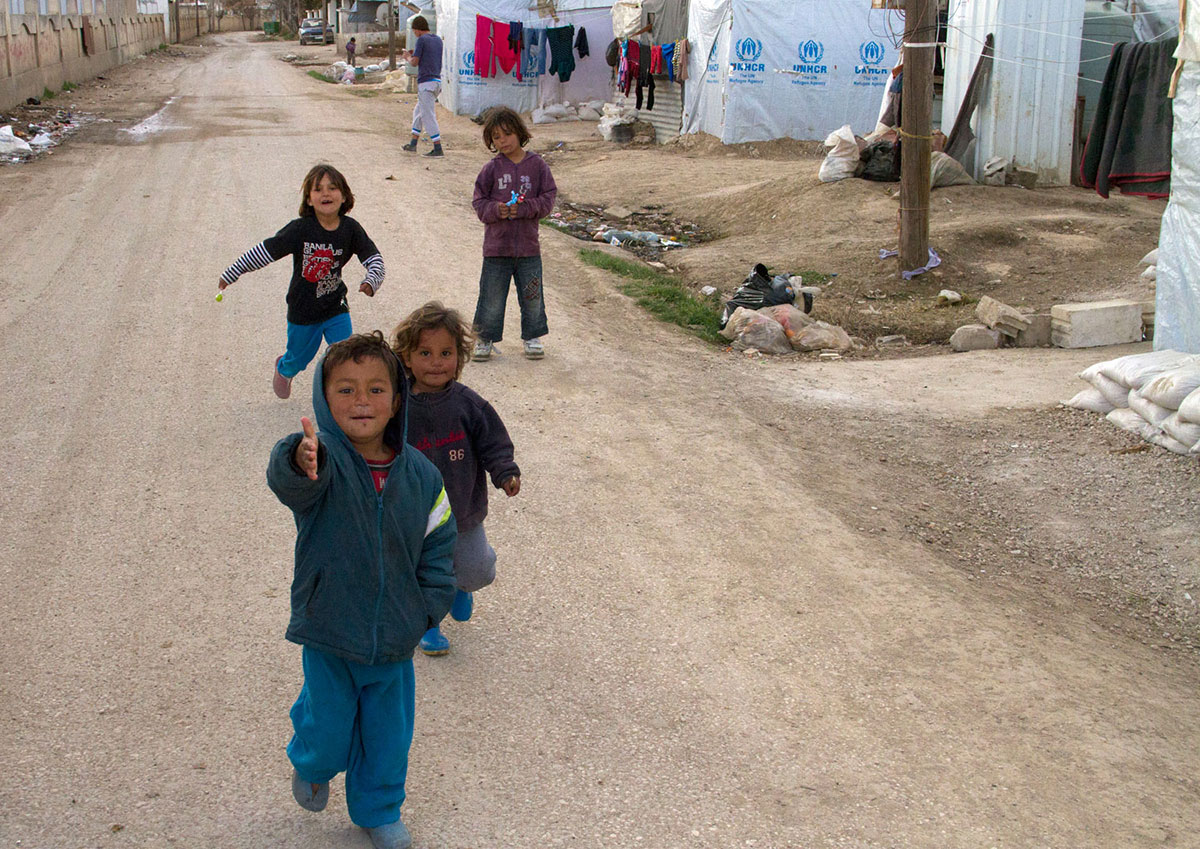 Many children populate the informal Jarrahia settlement. [Changiz M Varzi/Al Jazeera]