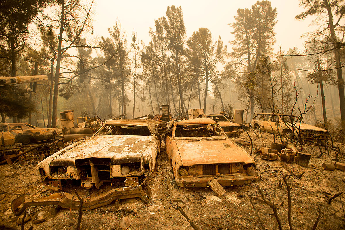 Vintage cars destroyed in Morgan Hill, California, after a heatwave exacerbated a wildfire that burned buildings and forced people from their homes in the US state. [Noah Berger/AP]