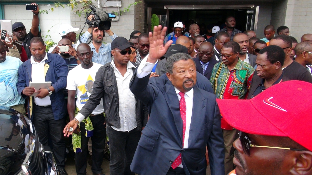 Ping, who narrowly lost presidential vote, urges supporters to end violence, as post-election unrest claims more lives.