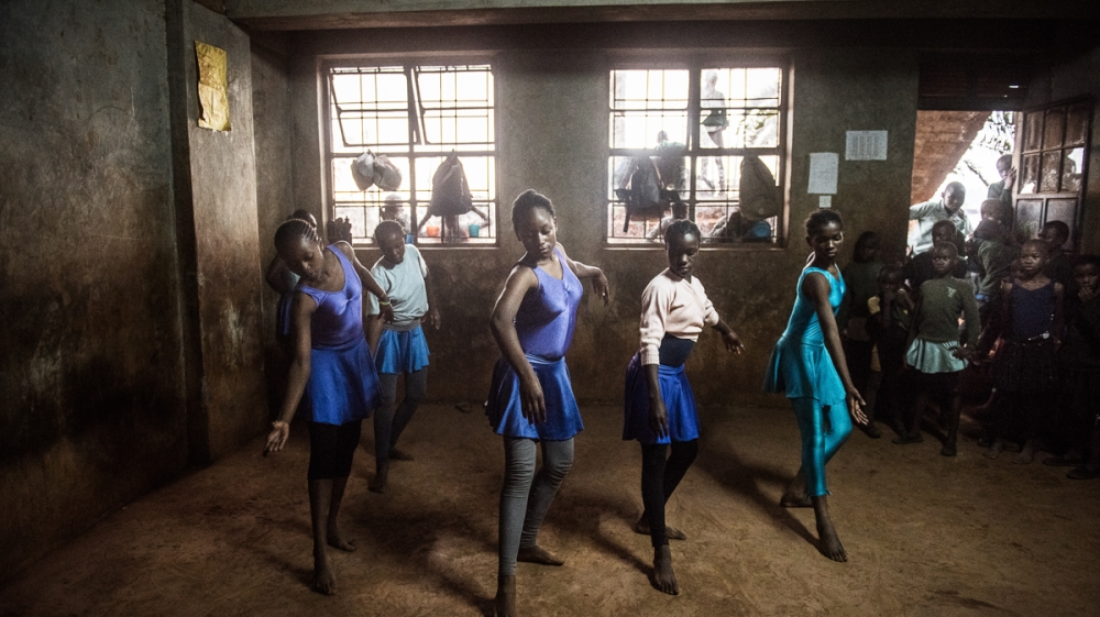 Classical music, colourful clothes and teachers' voices mix to turn the grey cold room into a real ballet studio.
