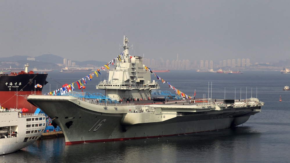 Taiwan urges calm as Chinese warship enters strait