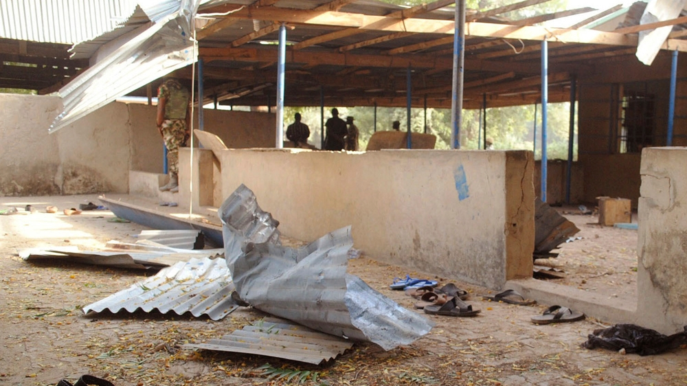 Nigeria military jet mistakenly bombs refugee camp 'killing 100'