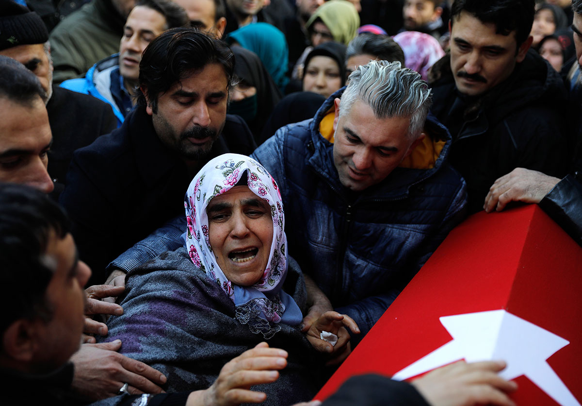 The mother of Fatih Cakmak, a security guard and a victim of an attack by a gunman at the Reina nightclub, during his funeral in Istanbul. [Umit Bektas/Reuters]