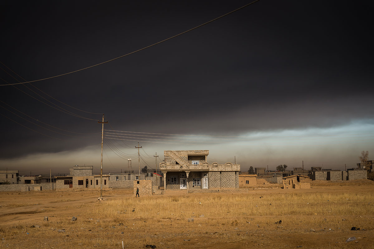 Thick black smoke rises from the burning oil wells of Qayyarah. The wells were set ablaze by retreating ISIL fighters. [Claire Thomas/Al Jazeera]