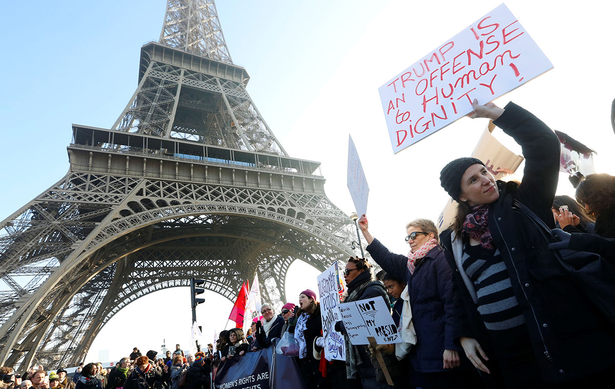 Protesters take part in the Women's March in Paris, France. [Jacky Naegelen/Reuters]
