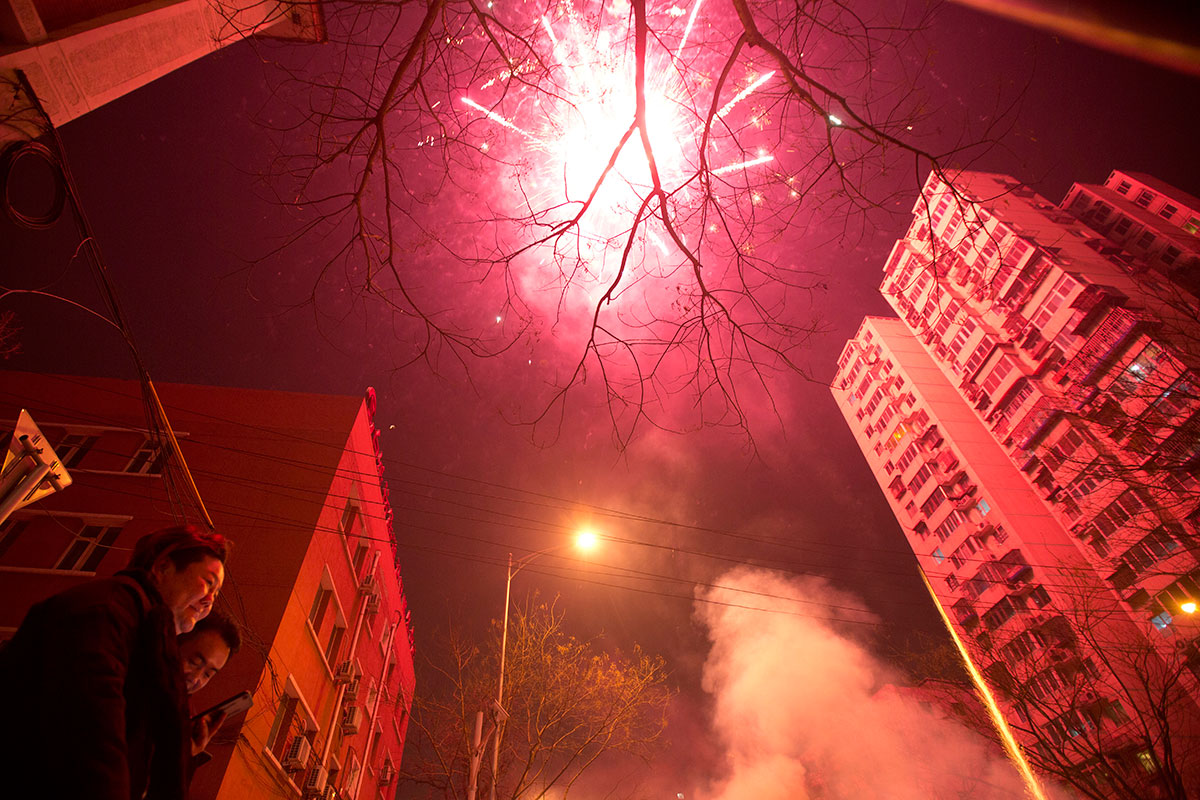 Residents set off fireworks on the eve of Lunar New Year in Beijing, China. [Ng Han/AP Photo]