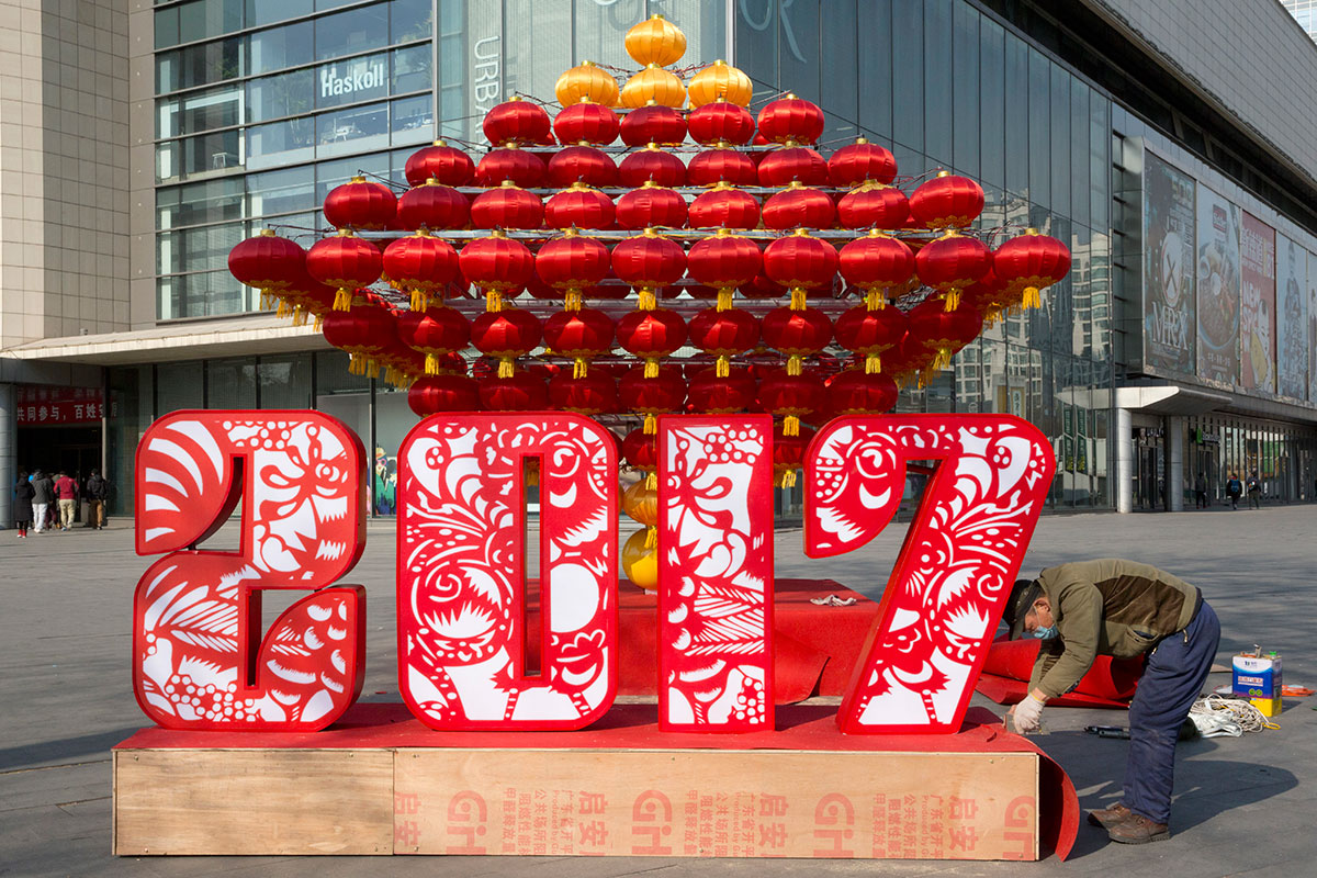 a worker prepares chinese new year decorations outside a mall in beijing china chinese - When Does The Chinese New Year Start