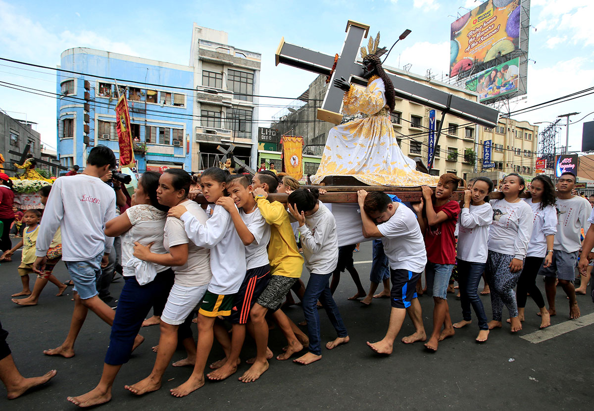 The Black Nazarene procession is an annual event attended by millions of Catholic devotees in the Philippine capital, Manila. [Romeo Ranoco/Reuters]