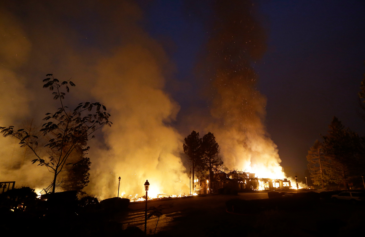 Smoke and flames from fire at the Hilton Sonoma Wine Country hotel in Santa Rosa, California. [Jeff Chiu/AP Photo]