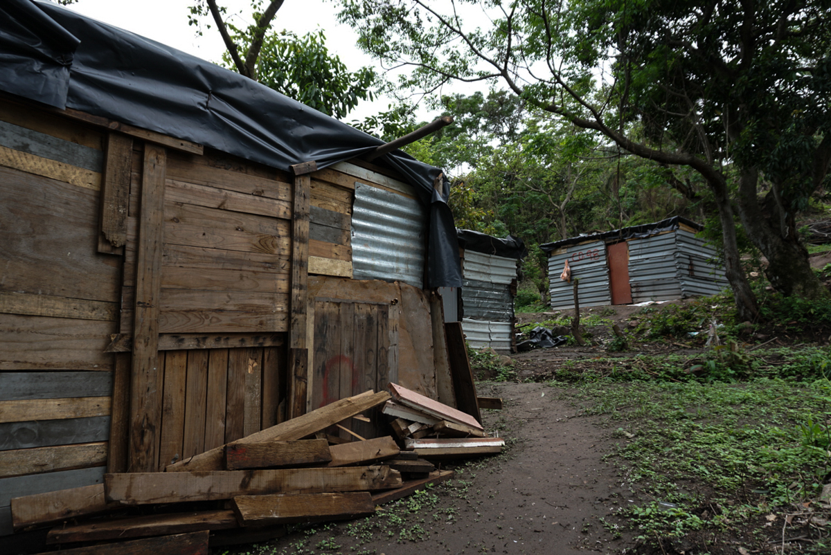Homes are made of wood, steel and often topped by plastic sheeting. [Azad Essa/Al Jazeera]