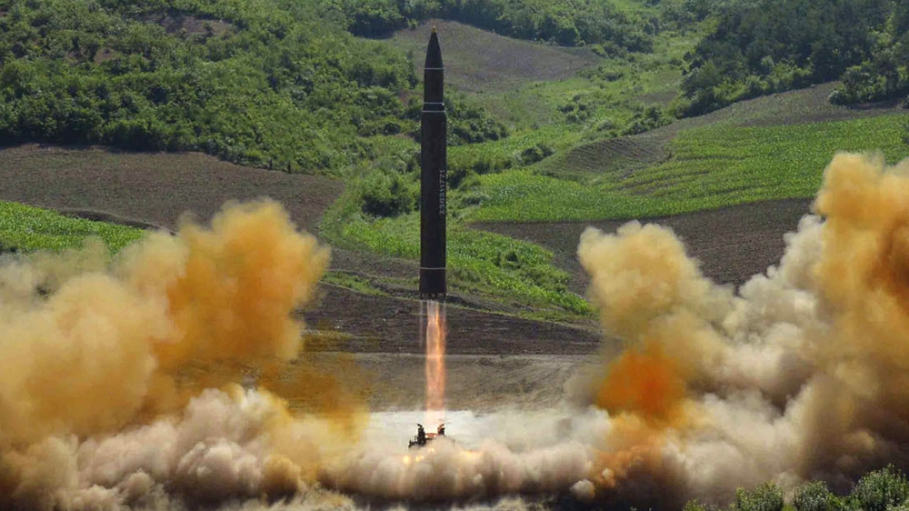 This file photo distributed by the North Korean government shows what was said to be the launch of a Hwasong-14 intercontinental ballistic missile, ICBM, in North Korea's northwest, Tuesday, July 4,