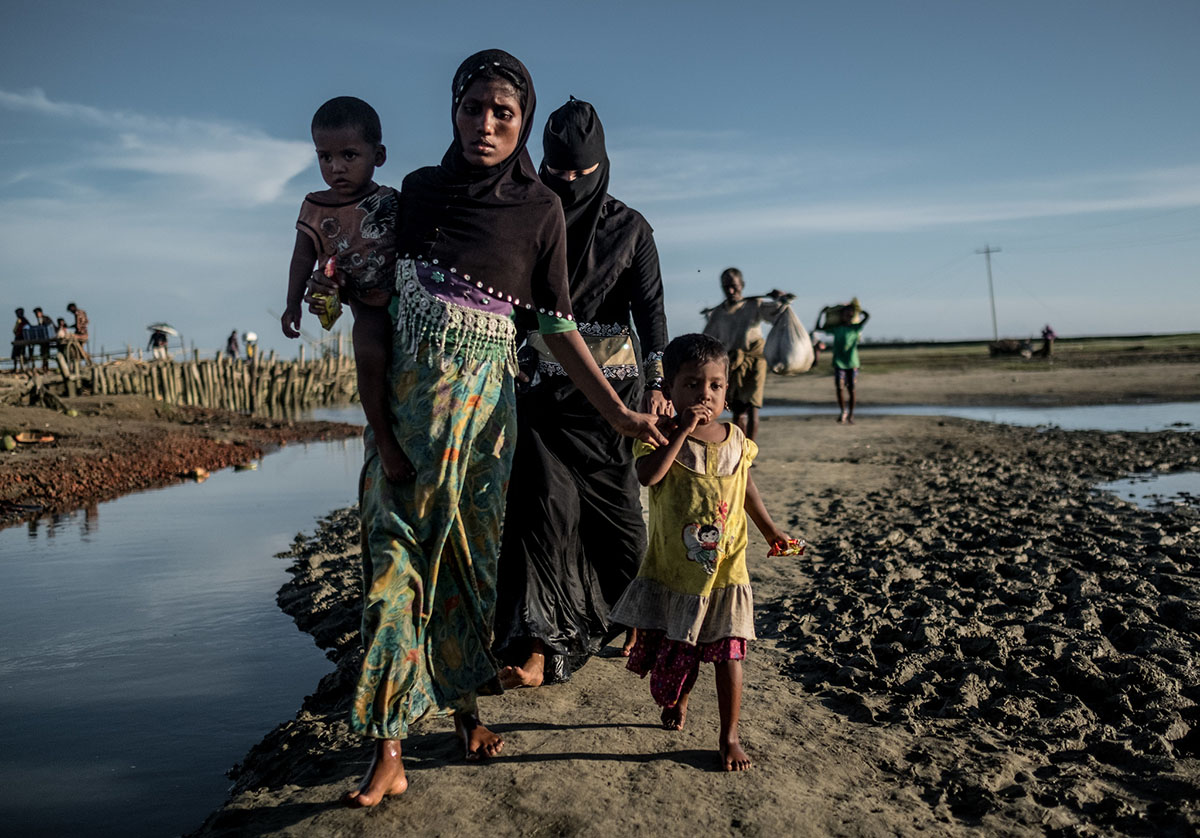 Laila*, 18, is pictured with her son, 18-month-old Abdul*, and daughter, two-year-old Jida*. Laila has been living in Balukhali Camp. She is five months pregnant and arrived in Bangladesh by boat with her two young children. [Tommy Trenchard/Oxfam/Al Jazeera]