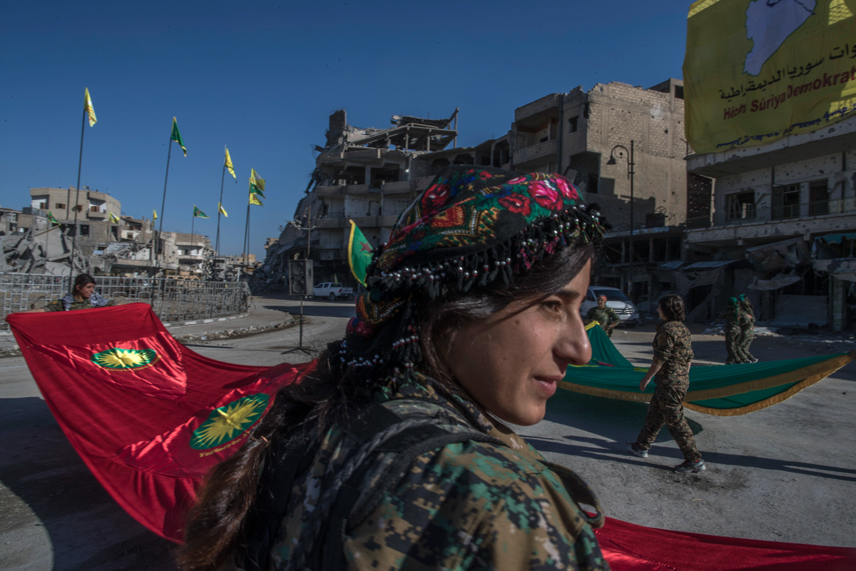Fighters from the Women's Protection Units (YPJ) hold a celebration in Raqqa's Paradise Square. The Kurdish female fighters, who took part in freeing the northern Syrian city from the ISIL, said they will continue their fight to liberate women from the brutal rule of ISIL. [Gabriel Chaim/AP Photo]