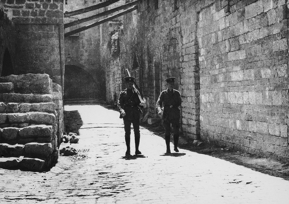 British soldiers patrol the streets of Jerusalem during a visit by Arthur James Balfour, a British Conservative politician, on April 2, 1925. The city's Arab residents were on strike as a protest against the Balfour Declaration, which supported plans for a Jewish homeland in Palestine. [Topical Press Agency/Hulton Archive/Getty Images]