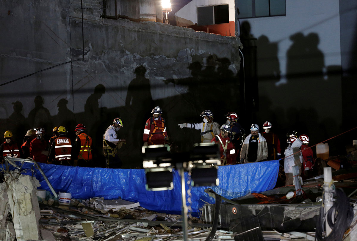 Members of a rescue team work in the rubble of a collapsed building in Mexico City. [Daniel Becerrill/Reuters]