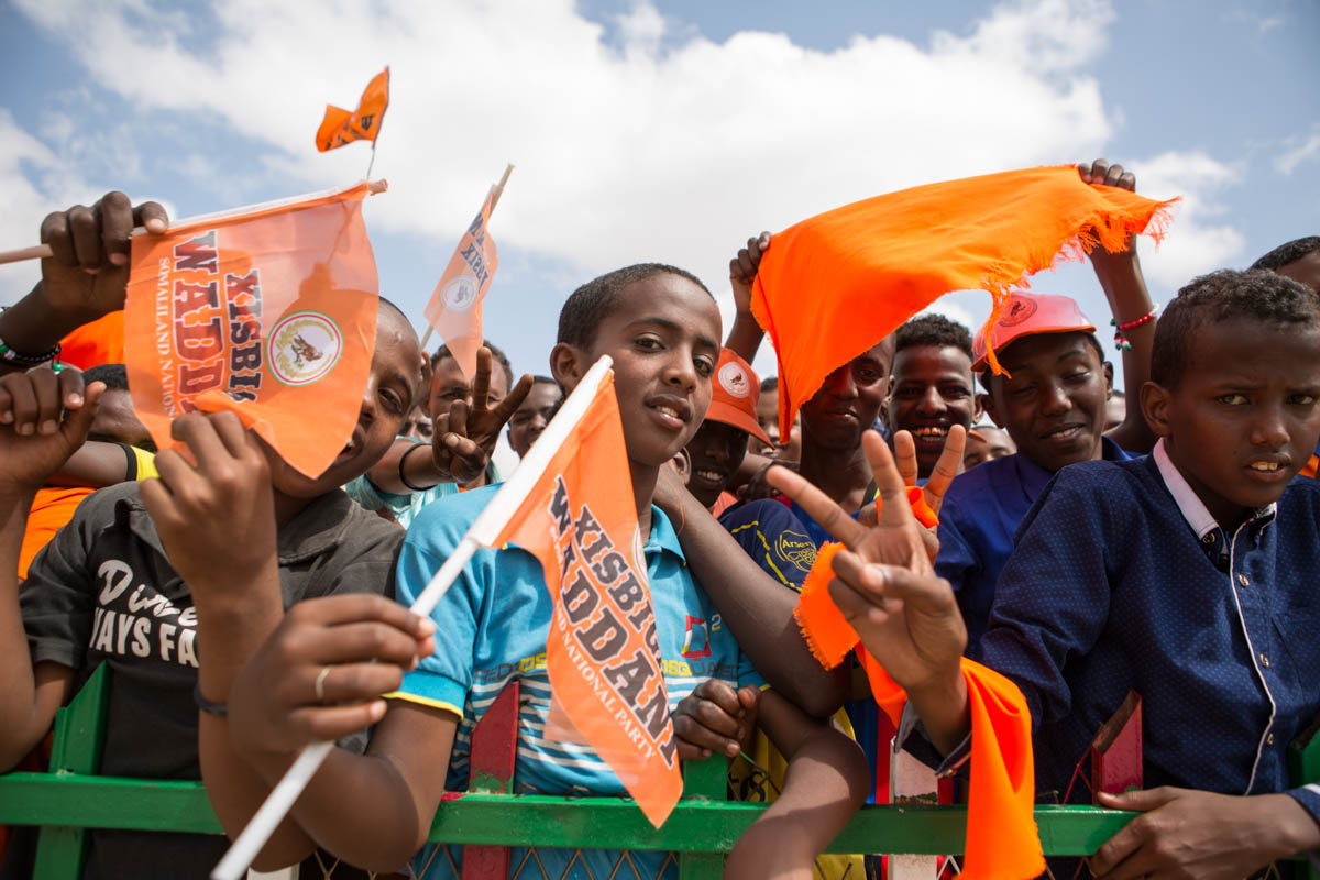 Young supporters of Waddani (Somaliland National Party) – many under 16 and therefore not yet old enough to vote – gather in Freedom Park in Somaliland's capital city, Hargeisa. An estimated 70 percent of the population are under 30. [Kate Stanworth/Saferworld/Al Jazeera]