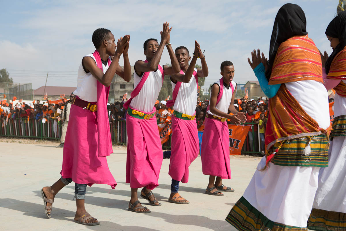 Traditional Somali dancers perform at a Waddani rally in Freedom Park, Hargeisa. Religious leaders expressed concern to the National Electoral Commission (NEC) about what they consider to be 'un-Islamic behaviour' during the campaigns, with the playing of music and men and women dancing together. The NEC however, let the rallies go ahead, arguing that the right to campaign is written into the constitution. [Kate Stanworth/Saferworld/Al Jazeera]