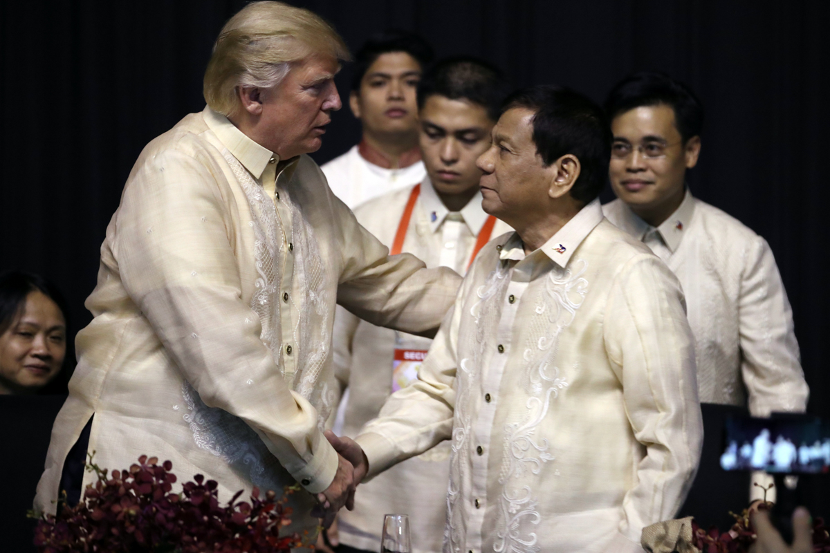 US President Donald Trump shakes hands with Philippines President Rodrigo Duterte at an ASEAN Summit dinner in Manila, Philippines. [Andrew Harnik/AP Photo]