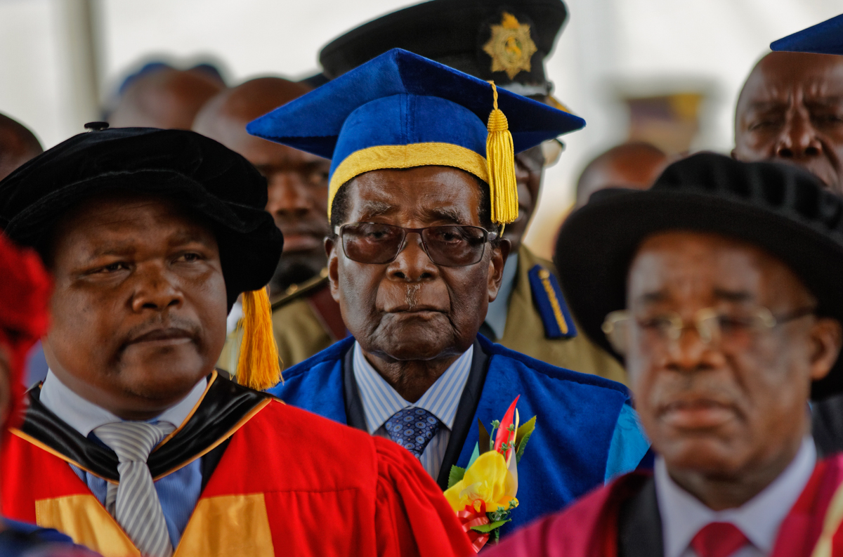 Zimbabwe's President Robert Mugabe arrives to preside over a student graduation ceremony at Zimbabwe Open University on the outskirts of Harare. It was Mugabe's first public appearance since the military put him under house arrest earlier this week. [Ben Curtis/AP Photo]