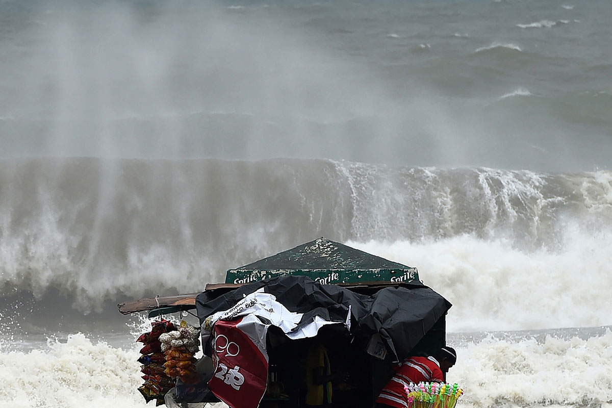 The developing cyclone produced strong winds, which whipped up huge waves, making beach vending a more risky affair in Colombo, Sri Lanka. [Ishara S. Kodikara/AFP]